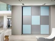 Armario empotrado de puertas corredera, a medida, perfileria four, puerta melamina gris/lacobel azul, decoración japonesa.