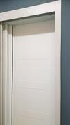 Armario empotrado a medida corredera, perfilería sport blanco, puerta lacada blanca fresado.