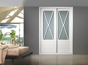 Frente de armario de puertas correderas, a medida,  perfilería sport lacado blanco fresado aspas, puertas lacado blanco aspas cristal laminar mate.