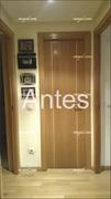 Puerta abatible en haya vaporizada con greca, original