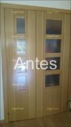 Puerta abatible vidriera en haya vaporizada con greca, original